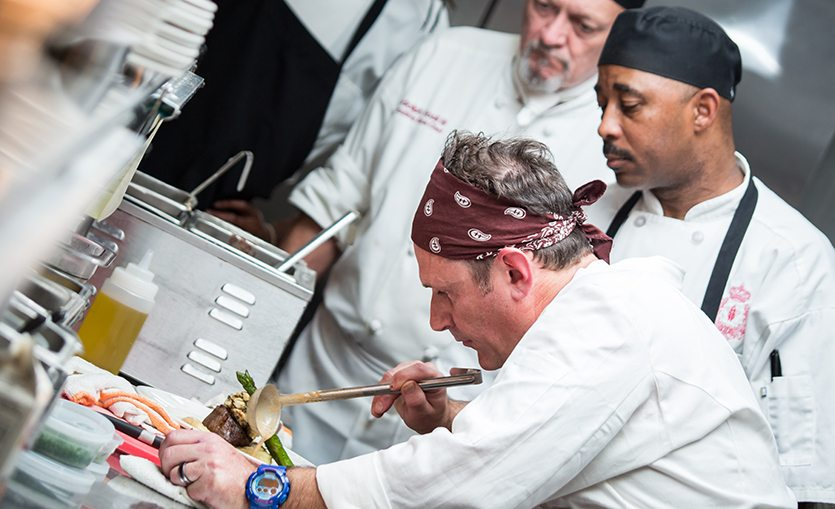 Creole Cuisine Chef puts the finishing touches on a dish